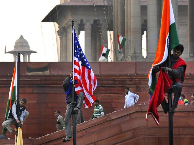 US and Indian flags are intalled on poles near Vijay Chowk during Republic Day rehearsals in New Delhi. (Saumya Khandelwal/ HT photo)