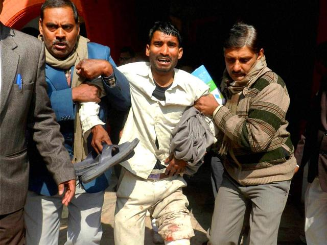 An-injured-is-rushed-to-a-government-hospital-after-a-crude-bomb-explosion-in-the-civil-court-premises-in-Ara-Bihar-PTI-photo