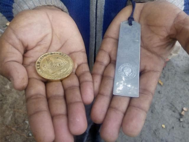 The-gold-coin-with-the-seal-of-the-US-President-and-the-scale-presented-to-Ramdas-and-his-family-by-Barack-Obama-during-his-last-visit-to-India-in-2010-HT-photo