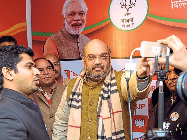 BJP-National-President-Amit-Shah-inaugurating-Selfie-Booth-for-the-Upcoming-Delhi-Assembly-Election-at-Khan-Market-Sonu-Mehta-HT-Photo