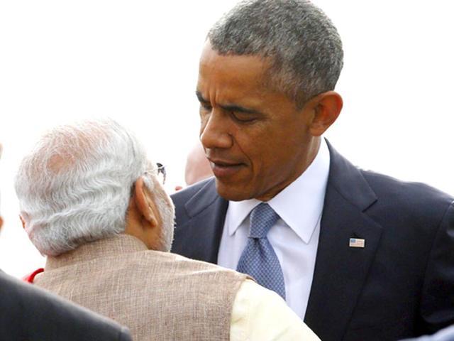 US-President-Barack-Obama-hugs-Prime-Minister-Narenda-Modi-as-he-arrives-at-Air-Force-Station-Palam-in-New-Delhi-Reuters-Photo