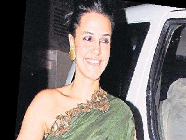 The-do-saw-a-number-of-personalities-from-Bollywood-Actors-Neha-Dhupia-was-spotted-in-a-green-off-shoulder-attire