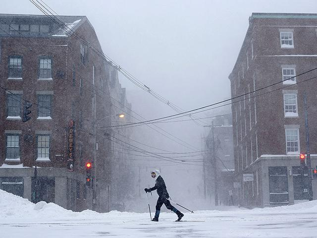 A-woman-cross-country-skis-on-Commercial-Street-in-Portland-Maine-AP-Photo