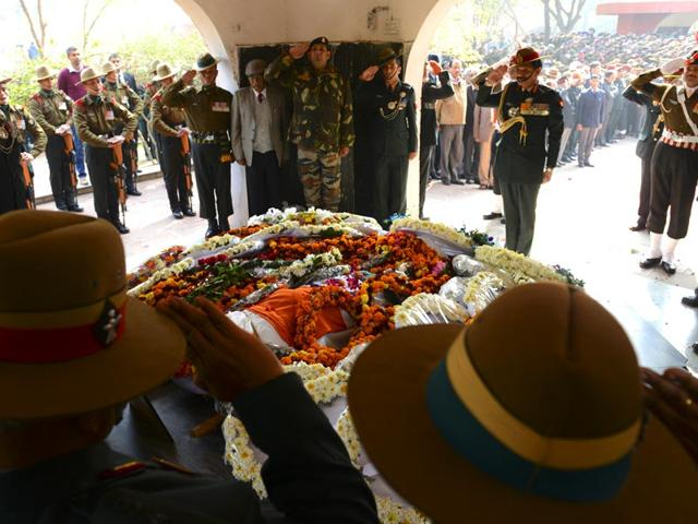 The-daughter-of-Col-MN-Rai-cries-as-she-salutes-to-pay-her-last-respect-to-the--mortal-remains-during-his-cremation-in-the-Delhi-Cantonment-Vipin-kumar-HT-Photo