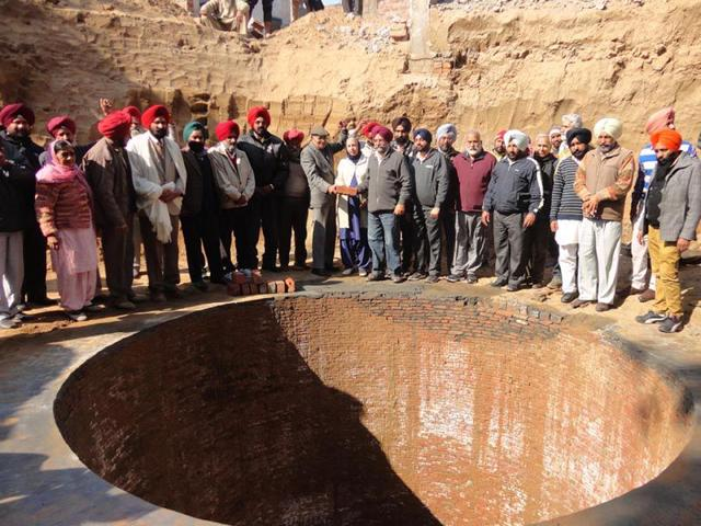 A-gathering-around-Shaheedanwala-Khuh-formerly-Kalianwala-Khuh-after-the-foundation-stone-laying-ceremony-at-the-well-in-Ajnala-in-Amritsar-district-on-Thursday-Sameer-Sehgal-HT