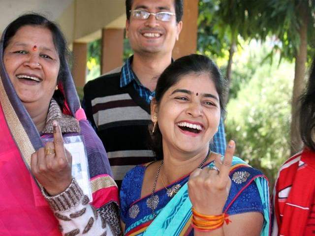 Women-show-their-index-finger-after-casting-their-vote-during-municipal-election-in-Indore-on-Saturday-Shankar-Mourya-HT-photo