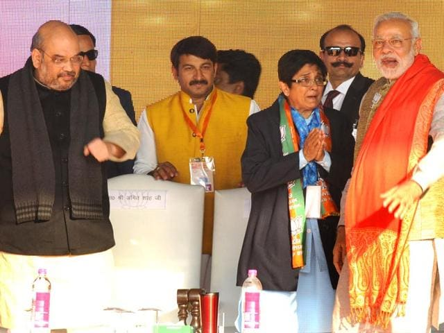 Prime-Minister-Narendra-Modi-with-BJP-s-Delhi-chief-ministerial-candidate-Kiran-Bedi-and-BJP-president-Amit-Shah-at-an-election-rally-in-Karkardooma-in-New-Delhi-Mohd-Zakir-HT-Photo