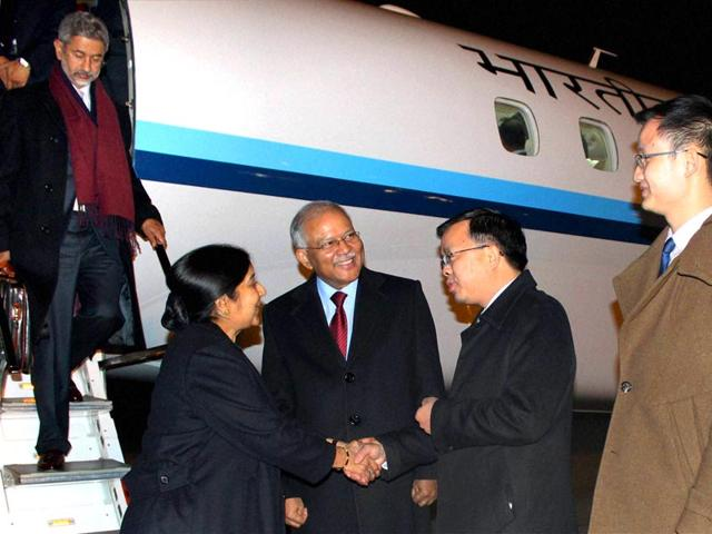 External-affairs-minister-Sushma-Swaraj-accompanied-by-foreign-secretary-S-Jaishankar-L-being-welcome-on-her-arrival-at-the-Beijing-International-Airport-in-Beijing-on-Saturday-Swaraj-on-a-four-day-visit-to-China-PTI-photo
