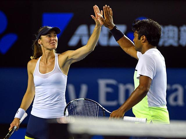 Martina-Hingis-and-Leander-Paes-beat-Daniel-Nestor-and-Kristina-Mladenovic-6-4-6-3-in-the-Australian-Open-mixed-doubles-tennis-final-in-Melbourne-AFP-Photo