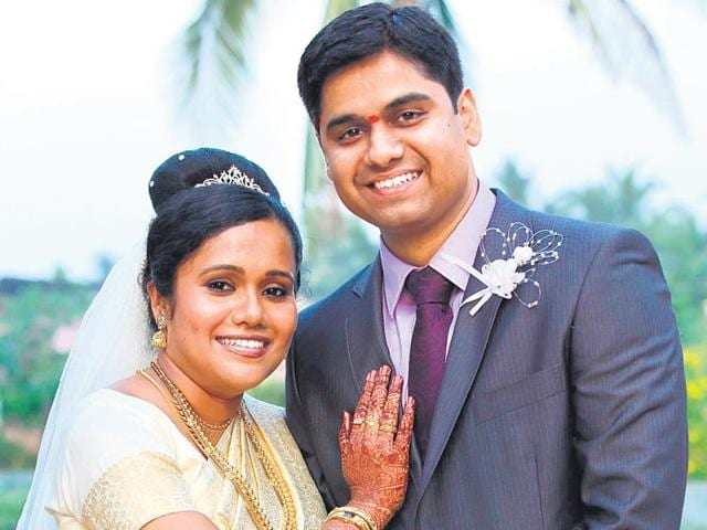 Glory-george-and-her-husband-Bipin-on-their-wedding-day-Theirs-was-a-traditional--Malayali-Christian-wedding--complete-with-flowing-veil-and-multi-layered-cake-but-she-also-had-an-intricate-floral-pattern-painted-on-her-arms-in-henna-