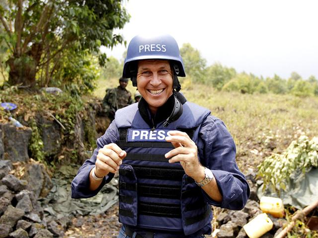 Al-Jazeera-journalist-Peter-Greste-poses-for-a-photograph-in-Kibati-village-near-Goma-in-the-eastern-Democratic-Republic-of-Congo-in-this-August-7-2013-file-photo-Reuters