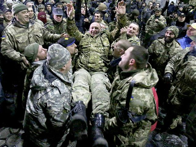 Fighters-of-the-Aydar-Ukrainian-volunteer-battalion-throw-up-their-commander-Sergiy-Melnichuk-as-they-celebrate-at-the-Ukrainian-defence-ministry-in-Kiev-after-an-action-which-prevented-the-disbandment-of-their-battalion-AFP-Photo