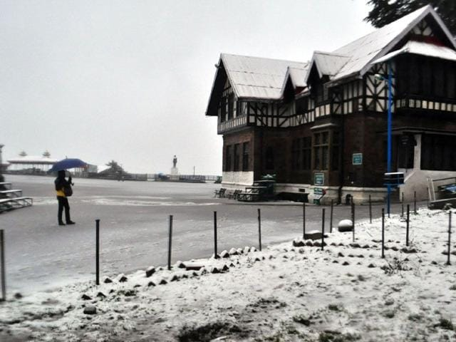 People-walk-during-heavy-snowfall-in-Srinagar-Kashmir-valley-experienced-fresh-snowfall-prompting-authorities-to-suspend-traffic-on-Srinagar-Jammu-national-highway-and-air-service-PTI-Photo
