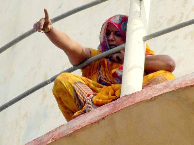 Savitri-Devi-a-resident-of-Agra-s-Akola-block-climbed-a-water-tank-on-Tuesday-to-protest-against-alleged-administrative-apathy-HT-Photo