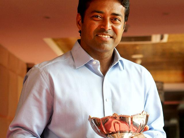Ace-tennis-player-Leander-Paes-poses-with-the-Australian-Open-mixed-doubles-trophy-at-a-hotel-in-Mumbai-Arijit-Sen-HT-photo