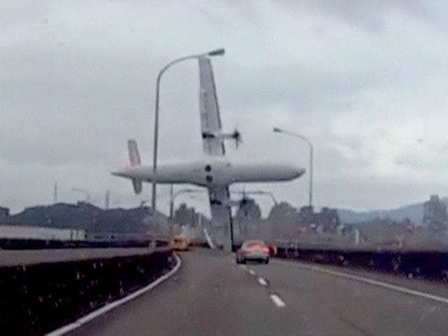 A-still-image-taken-from-an-amateur-video-shot-by-a-motorist-shows-the-TransAsia-Airways-plane-cartwheeling-over-a-motorway-soon-after-the-turboprop-ATR-72-600-aircraft-took-off-in-New-Taipei-City-Reuters