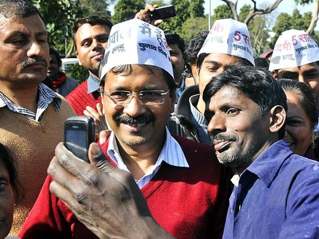 An-AAP-supporter-clicks-a-selfie-with-party-convener-and-New-Delhi-chief-miniterial-candidate-Arvind-Kejriwal-at-his-constituency-in-Panchkuian-Road-New-Delhi-Sushil-Kumar-HT-photo