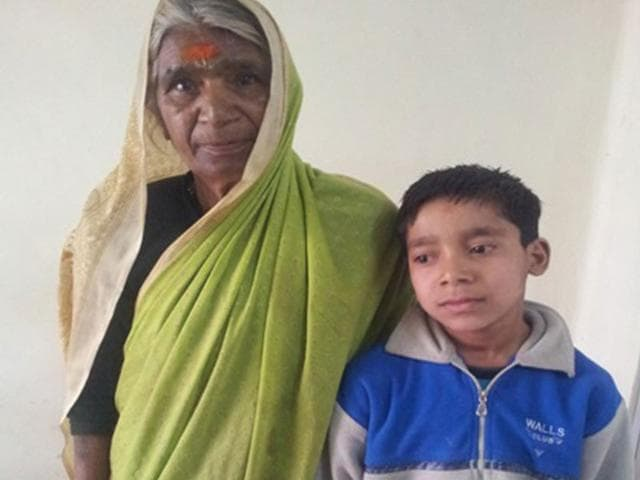 A-rescued-child-with-his-family-member-in-Bhopal-HT-photo