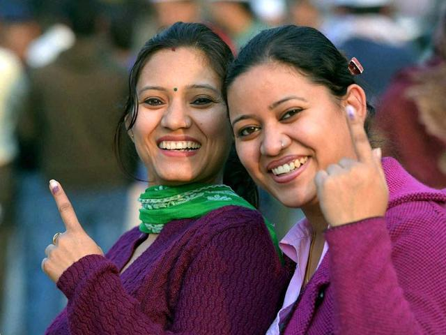 Women-show-their-inked-fingers-after-casting-votes-for-Assembly-elections-at-a-polling-station-in-East-Delhi-PTI-photo