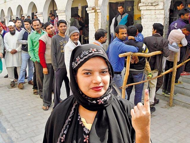 A-Muslim-woman-displays-her-inked-finger-at-a-booth-in-Trilokpuri-on-Saturday-Virendra-Singh-Gosain-HT-Photo