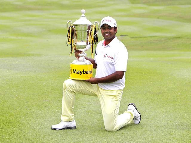 Anirban-Lahiri--poses-with-his-trophy-for-photographers-after-winning-the-Malaysian-Open-golf-tournament-at-Kuala-Lumpur-Golf-and-Country-Club-in-Kuala-Lumpur-AP-Photo-Joshua-Paul