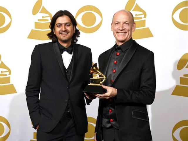 Ricky-Kej-and-Wouter-Kellerman-of-Winds-of-Samsara-pose-with-their-trophy-that-they-won-in-the-new-age-album-category-at-the-57th-annual-Grammy-Awards-in-Los-Angeles-on-Sunday-AP