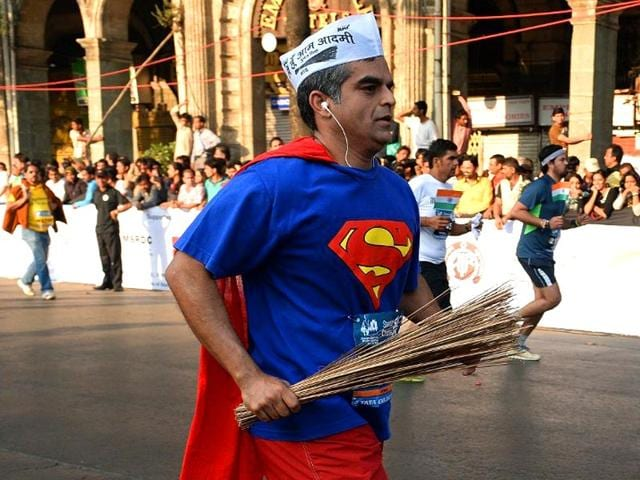 An-Aam-Aadmi-Party-supporter-carrying-the-party-s-election-symbol-the-broom-AFP-Photo