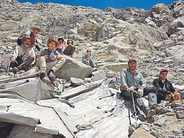 Chilean-mountaineers-pose-on-what-they-say-is-the-wreckage-of-a-plane-that-crashed-in-the-Andes-54-years-ago-killing-24-people-AP-photo