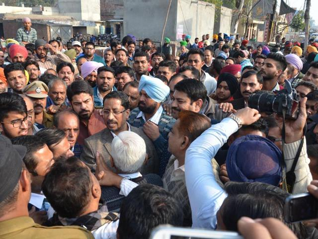 Punjab-local-bodies-minister--Anil-Joshi-talking-to-BJP-workers-during-a-protest-against-the-Akalis-in-Tarn-Taran-on-Tuesday-Sameer-Sehgal-HT