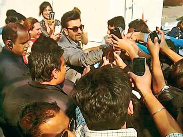 Ranbir Kapoor shoots for Tamasha outside gate no 14 of Nehru Stadium in the national capital. Several fans gathered outside the actor's vanity van to catch a glimpse of him and click pictures. Least perturbed, Ranbir smiled through it all.