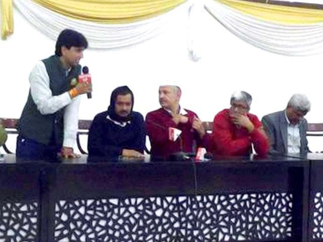 Arvind-Kejriwal-looks-on-as-Kumar-Vishwas-speaks-at-an-AAP-legislative-party-meeting-after-the-Delhi-poll-results-were-announced-on-Tuesday-PTI-Photo-Twitter