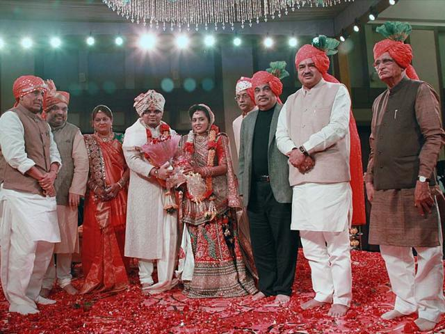 BJP-president-Amit-Shah-with-his-newly-married-son-daughter-in-law-and-other-guests-HT-Photo
