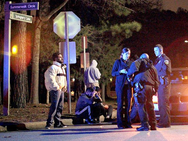 Chapel-Hill-police-officers-investigate-the-scene-of-three-murders-near-Summerwalk-Circle-in-Chapel-Hill-North-Carolina-AP-Photo