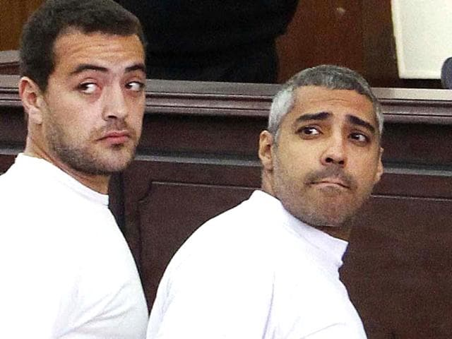 Al-Jazeera television journalists Mohamed Fahmy and Baher Mohammed before hearing a verdict at a court in Cairo. An Egyptian court sentenced three Al-Jazeera TV journalists to three years in prison for operating without a press licence and broadcasting material harmful to Egypt (AP Photo)