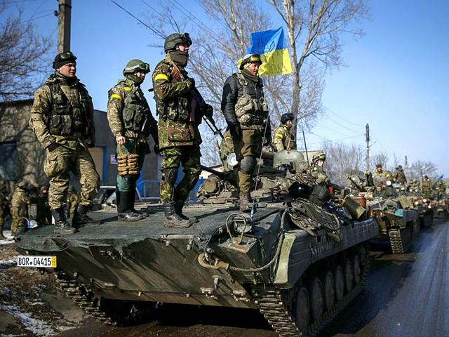 Members-of-the-Ukrainian-armed-forces-ride-on-armoured-personnel-carriers-APC-near-Debaltseve-eastern-Ukraine-Germany-France-Russia-and-Ukraine-agreed-a-deal-on-Thursday-that-offers-a-glimmer-of-hope-for-an-end-to-fighting-in-eastern-Ukraine-after-marathon-overnight-talks-Reuters-Photo