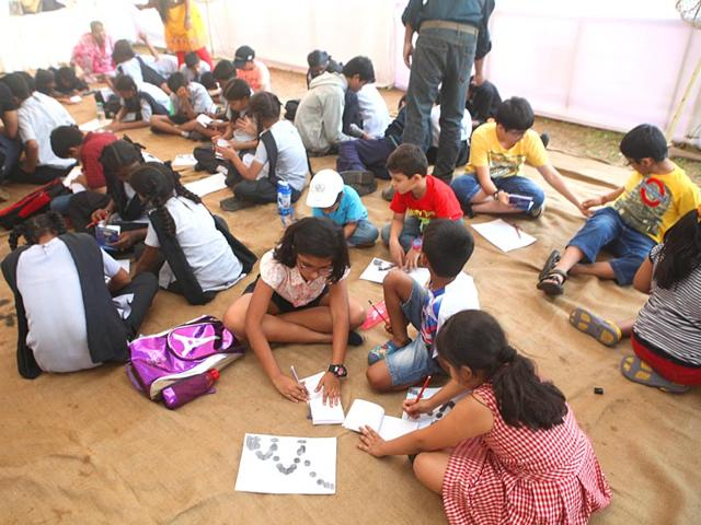 Children-attend-a-motion-media-arts-and-animation-workshop-by-an-NGO-where-you-get-to-make-your-own-movie-in-one-hour-using-just-a-small-notebook-and-pencil-at-the-HT-Kala-Ghoda-Arts-Festival-in-Mumbai-Kunal-Patil-HT-photo