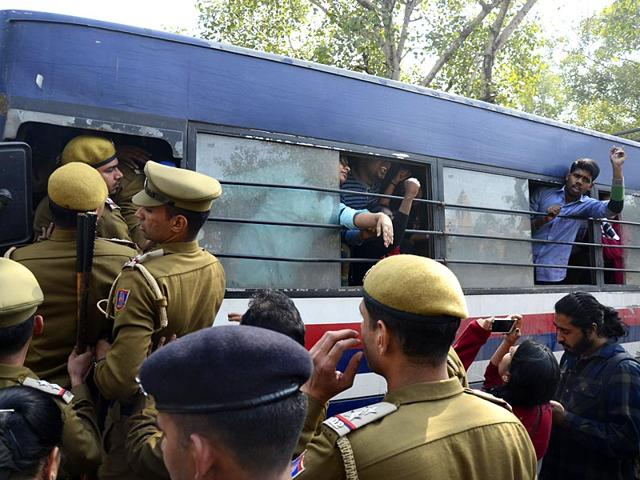 Student-activists-shout-slogans-from-inside-a-police-van-after-being-detained-during-a-protest-against-the-Hindu-Mahasabha-a-right-winged-Hindu-organisation-outside-the-Mahasabha-s-office-in-New-Delhi-AP-Photo