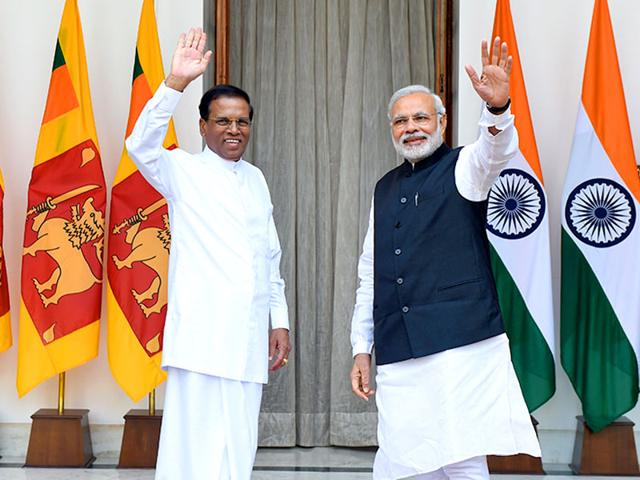 Prime-Minister-Narendra-Modi-R-and-Sri-Lankan-President-Maithripala-Sirisena-wave-prior-to-a-meeting-and-delegation-level-talks-in-New-Delhi-AFP-photo