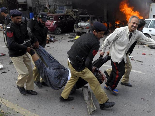 Pakistani-police-move-a-victim-of-a-bomb-attack-near-the-police-headquarters-in-Lahore-AFP-photo