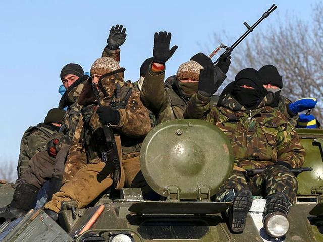 Members-of-the-Ukrainian-armed-forces-ride-on-a-military-vehicle-near-Debaltseve-eastern-Ukraine-Reuters