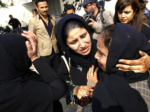 Relatives-of-a-Pakistani-female-polio-vaccination-worker-who-was-killed-by-unknown-gunmen-mourn-her-death-in-Karachi-Pakistan-on-Jan-21-2014-AP-file-photo
