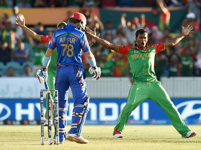 Bangladesh-bowler-Rubel-Hossain-R-celebrates-taking-the-wicket-of-Afsar-Zazai-of-Afghanistan-AFP-Photo