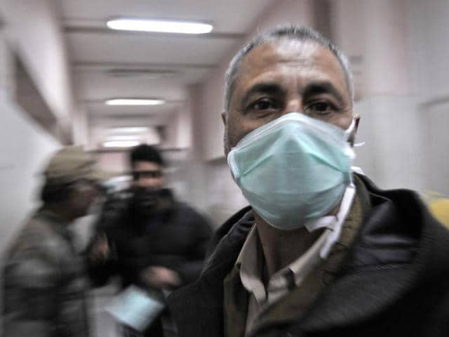 A-man-with-a-protective-mask-inside-the-Sher-e-Kashmir-Institute-of-Medical-Sciences-hospital-in-Srinagar-Waseem-Andrabi-HT