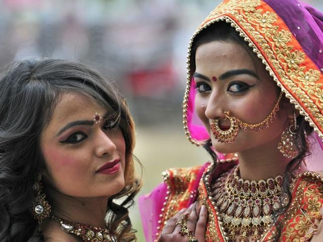 Students-attired-in-wedding-finery-during-a-fashion-show-on-the-first-day-of-the-Chandigarh-University-National-Youth-Fest-2015