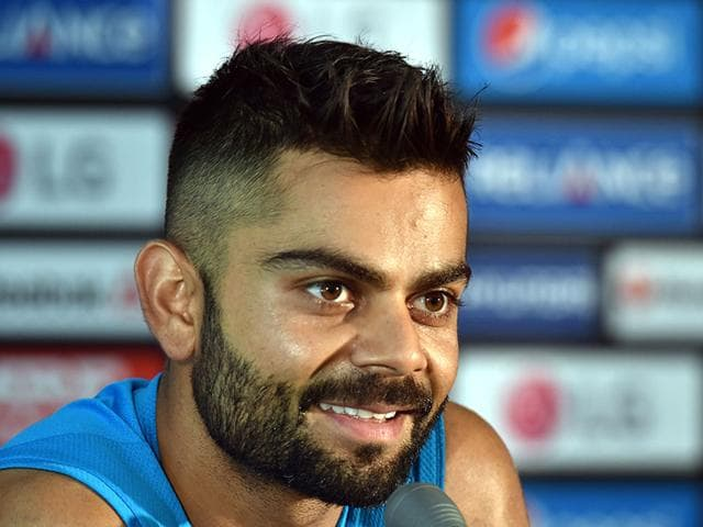 Virat-Kohli-sports-a-new-haircut-at-a-press-conference-in-Melbourne-ahead-of-India-s-World-Cup-2015-match-against-South-Africa-AFP-Photo