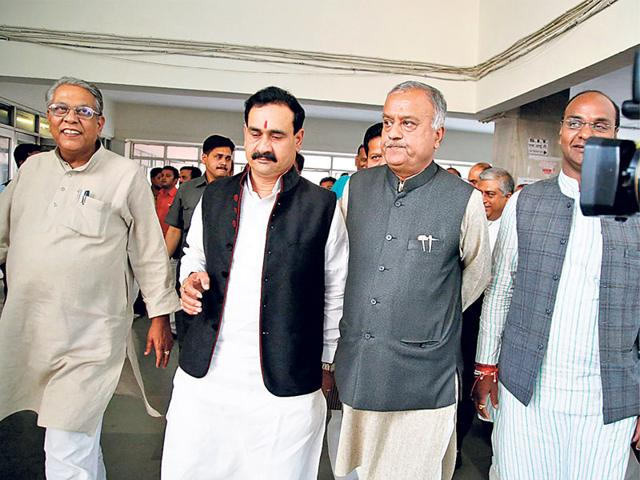 BJP-state-president-Nand-Kumar-Singh-Chauhan-right-with-other-party-leaders-at-the-Special-Investigation-Team-s-office-in-Bhopal-on-Friday-HT-photo