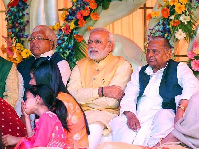 PM-Narendera-Modi-with-SP-national-president-Mulayam-Singh-Yadav-during-Mulayam-s-grand-nephew-Tej-Pratap-Singh-Yadav-s-Tilak-ceremony-in-Safai-HT-photo-Ashok-Dutta