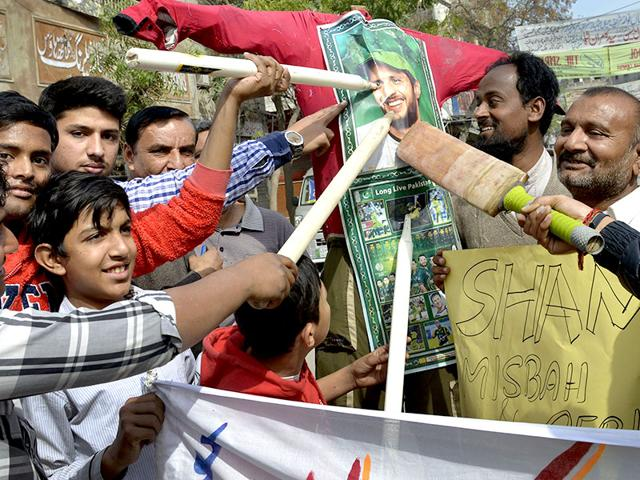 Pakistani-cricket-fans-point-to-a-picture-of-cricketer-Shahid-Afridi-displayed-on-an-effigy-of-team-captain-Misbah-ul-Haq-at-a-protest-following-the-defeat-of-Pakistan-by-the-West-Indies-AFP-Photo