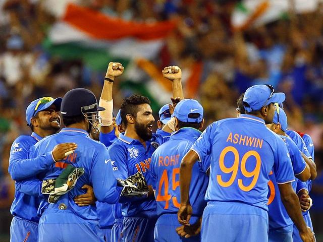 Indian-player-s-Suresh-Raina-M-S-Dhoni-and-Ravindra-Jadeja-celebrate-as-India-beat--South-Africa-s-by-130-runs-in-their-Cricket-World-Cup-pool-B-match-in-Melbourne-AP-Photo