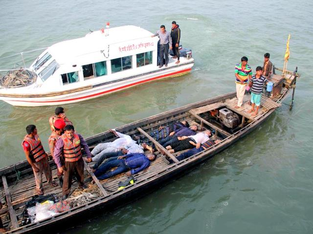 Bangladesh-officials-stand-on-a-boat-laden-with-the-bodies-of-ferry-accident-victims-at-Manikganj-around-30km-west-of-Dhaka-on-February-22-AFP-Photo
